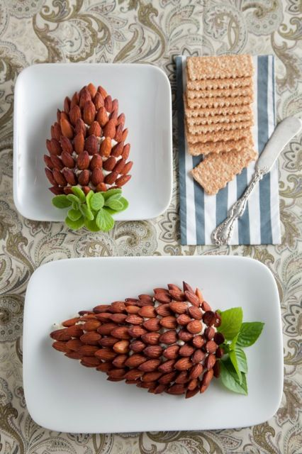 """Pine Cone"" Cheese Ball! A few simple ingredients as well as almonds lend an aesthetically pleasing effect to the typical cheese ball."