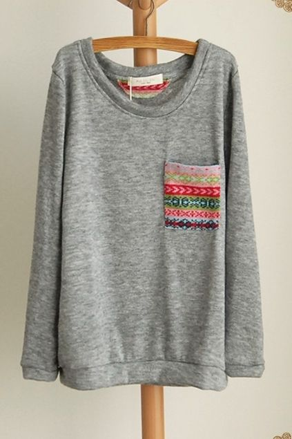 DIY Pocket- Sweatshirt: Buy any color Hanes sweatshirt, find any pattern of fabric you like, sew it as a pocket! Super easy and cute! Doin this to all of my old sweatshirts!