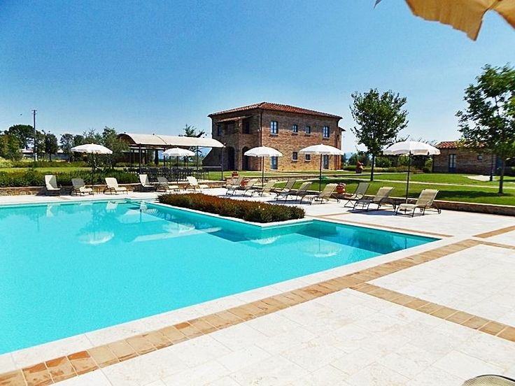 View of the pool area with Farmhouse in background . id:6552462 (holiday lettings) first review.