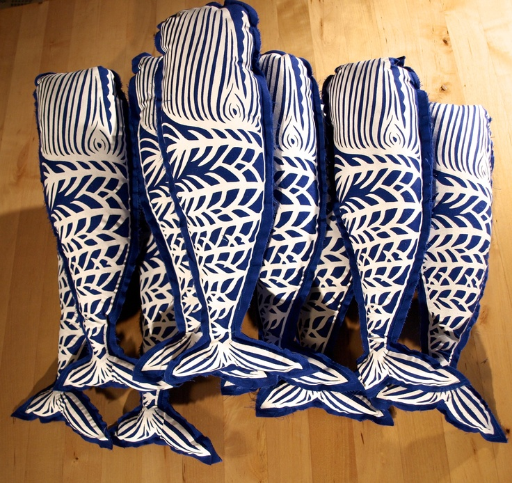 "Hand silk-screened deep royal blue whale pillow with white screen-print and matching deep royal blue back. This pillow has a raw edge for a rustic feel. I first cut the whale design out of a piece of paper, then I custom mix water-based (non-toxic) ink colors and silk screen each one by hand. Each pillow is sewn shut and filled with non-allergenic poly-fill. 14"" x 4 1/2""   www.sarahlawsmade.com"