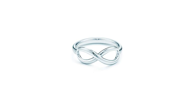 Tiffany & Co: TIFFANY INFINITY Ring Tiffany Infinity is a powerful symbol of continuous connection, energy and vitality. Graceful yet modern in design, the free-flowing curves of this ring are endlessly elegant. –Sterling silver
