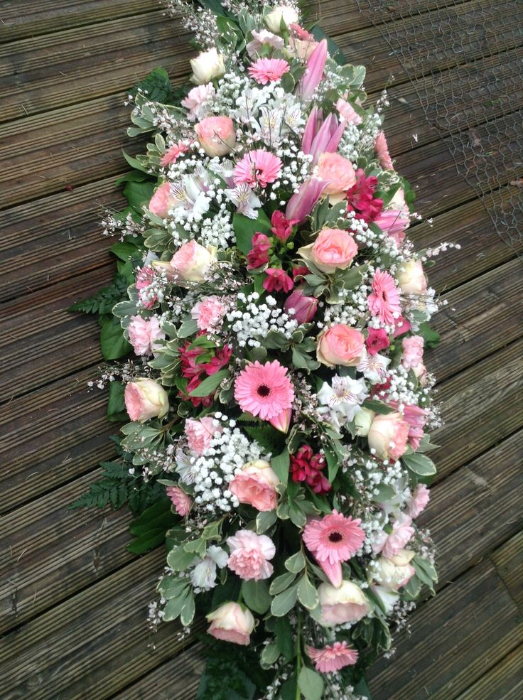 funeral casket spray, pink roses, pink gerbera, pink lilys, pink carnations and gyp. funeral coffin spray. www.thefloralartstudio.co.uk