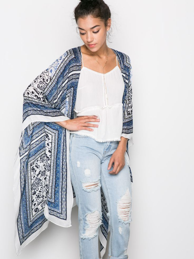 """Bohemian inspired floral printed kimono with an open front. Wear it on or wrapped around. One size fits all. 46"""" Length, Open Front 100% Cotton"""
