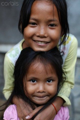 Phnom Penh girls - Cambodia ... a portrait of childlike purity and simple happiness!
