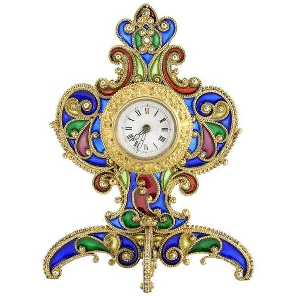 Preowned Unusual Austrian Silver Gilt And Plique-à-jour Enamel Desk... (300,390 INR) ❤ liked on Polyvore featuring home, home decor, clocks, multiple, picture frames, silver mantel clock, silver home accessories, floral home decor, silver clock and silver desk clock
