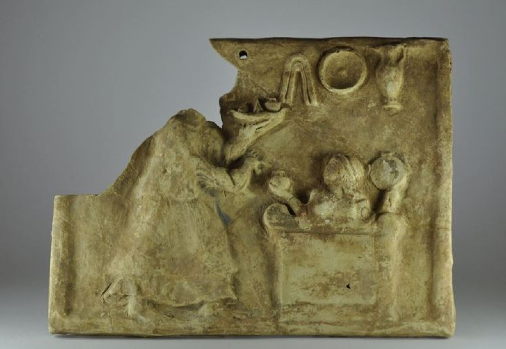 Pinakes, 5th century B.C. Greek terracotta relief, pinakes, with offerant in mystical cista offering a  pomegranate in hand, 26.5 cm x 20 cm high unpublished. Private collection