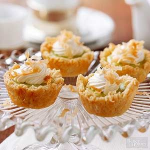 The cream cheese and macadamia nut crust deliciously complements the sweet lime filling in these tropical treats./