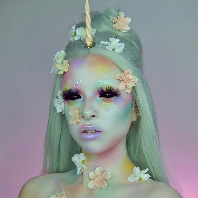 Unicorn with a touch of creepy  Who else wishes they could just be a unicorn everyday? Used @mehronmakeup white cream paint, @sugarpill pro palette and lumi pigment, @katvondbeauty pastel goth palette, @jazzy_glitter, unicorn horn I found on Etsy  eyes are edited
