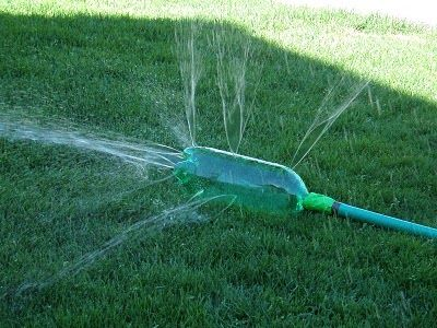 Homemade sprinkler from a 2 liter poked with holes...simple & cheap!