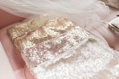Gorgeous GLITZ sequin cosmetic bag, available in all the same beautiful  GLITZ colors of our linens. Buy them as bridesmaid gifts, use it as your  personal clutch for the day and keep a memento of the color scheme of your  wedding, or give them as favors at bachelorette, birthday, rehearsal  dinner, or other parties.  Shown from top to bottom: Light Gold, Honey, Blush, Champagne.  Photo by Radian Photography of our actual product.