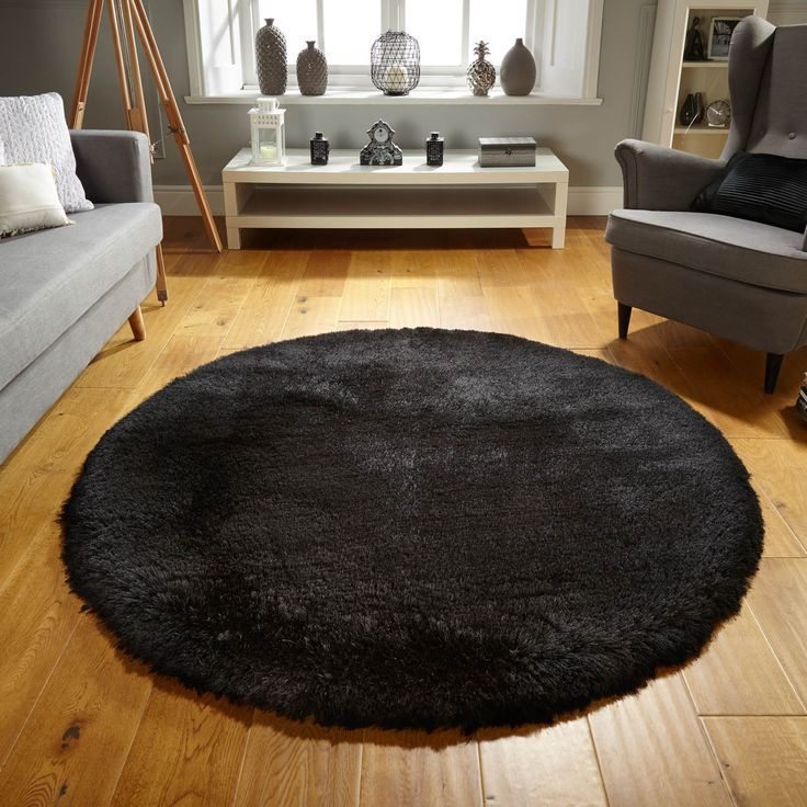 pearl circle rugs in black feature a luxurious silky pile made from polyester the super soft texture compromises of thick and thin yarns
