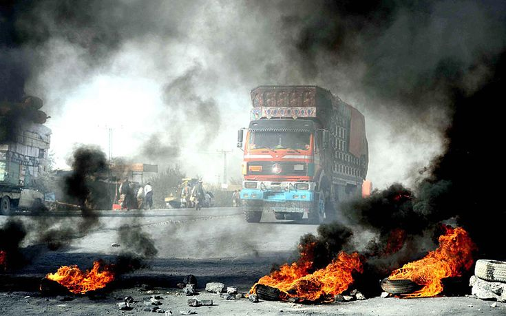 Local traders and transporters burn tyres and block the highway between Pakistan and Afghanistan to protest their treatment at the hands of custom and security forces