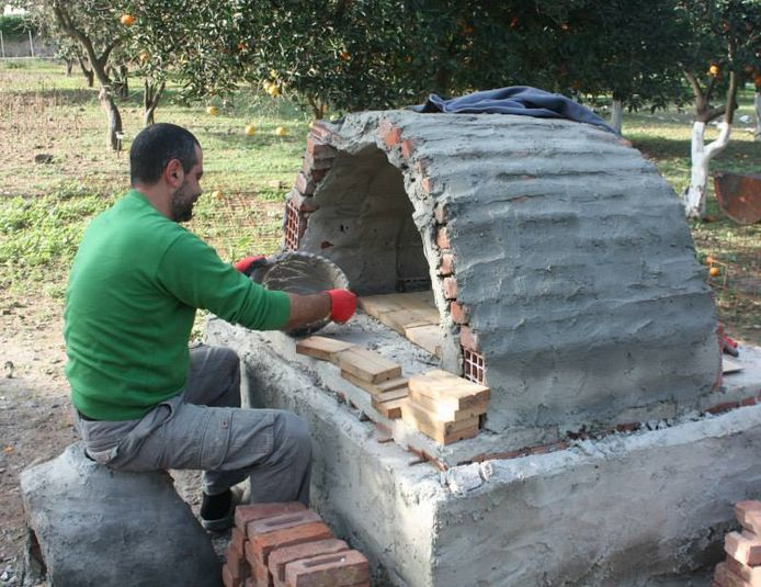 Cem building his brick oven at the Eco Farm