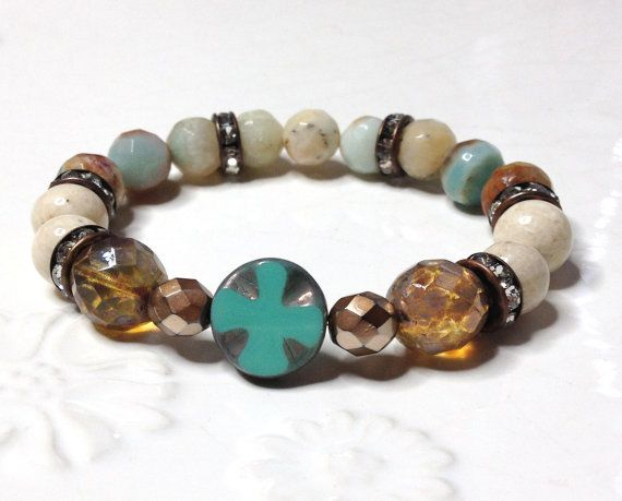 Fun, rustic, boho stretch bracelet...    A carved czech glass cross bead is surrounded by a beautiful mix of gemstones and czech beads. I used czech
