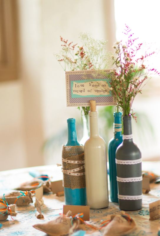 490 best wedding accents details images on pinterest flower wine bottle holds table info 7 awesome diy wine bottle centerpiece ideas for your big day junglespirit Choice Image