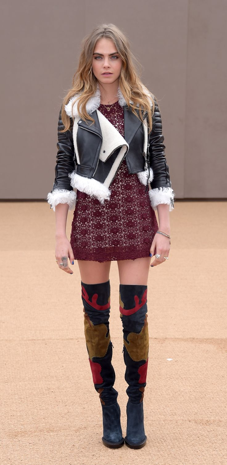 My Burberry star Cara Delevingne at the Burberry show space wearing over-the-knee boots and a burgundy lace dress from the A/W15 collection