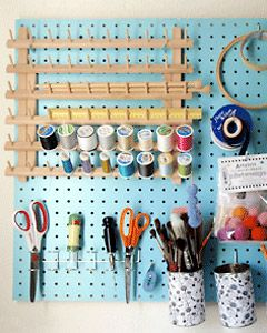 I was already going to do pegboard in my craft space, but I like that they painted this one. The spool holder is a nice idea too.