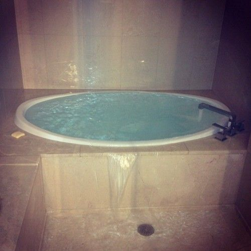 Inspiration - Infinity tub that could spill over into an open shower.