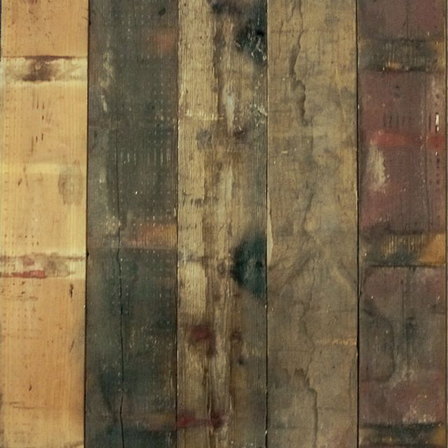 Reclaimed Railway pine from 19th century French railway carriages. These boards are created by cleaning,  de-nailing, and slicing 45mm carriage boards in half creating two lengths of original face. The appearance  is a mainly dark board, with some original grey/yellow/brown & red markings.