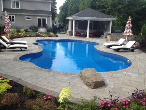 Create the pool patio of your dreams with the help of for Pool design help