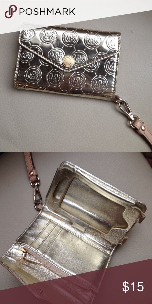 Michael Kors phone/wallet wristlet Gold Michael Kors phone and card holder. Has a coin purse, slots for 3 cards, and holds and iPhone 5 model. Has a wrist strap. Michael Kors Accessories Key & Card Holders