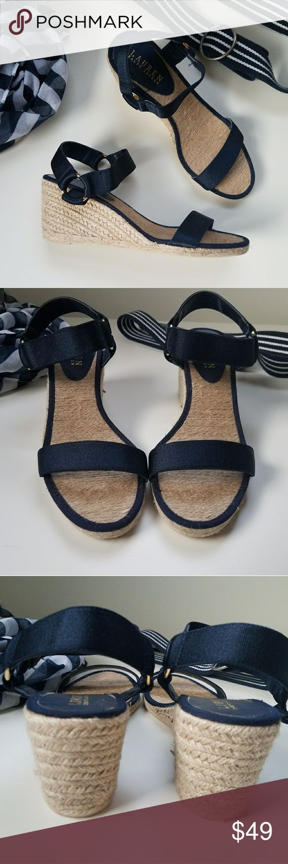 Lauren by Ralph Lauren Navy Banded Espadrilles These fabulous navy wedge sandals are a style staple, easy to wear they'll look great with summer dresses. The navy sandals are made from canvas material and feature a raffia wedge heel that is 3¾ inches in height.  ·    Navy Canvas straps  ·    Raffia 3¾ inch wedge heel  ·    Thick toe band strap  ·    Women's wedges Lauren Ralph Lauren Shoes Espadrilles