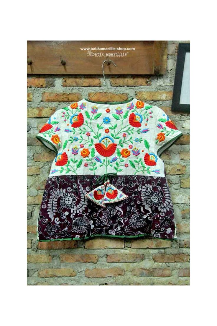 batik amarillis's garden vest This is when Indonesia's traditional textile :Tenun Gedog Tuban meets Hungarian embroidery This beautiful craftmanship features hand made tassel, pockets plus our signature Arcana in the back