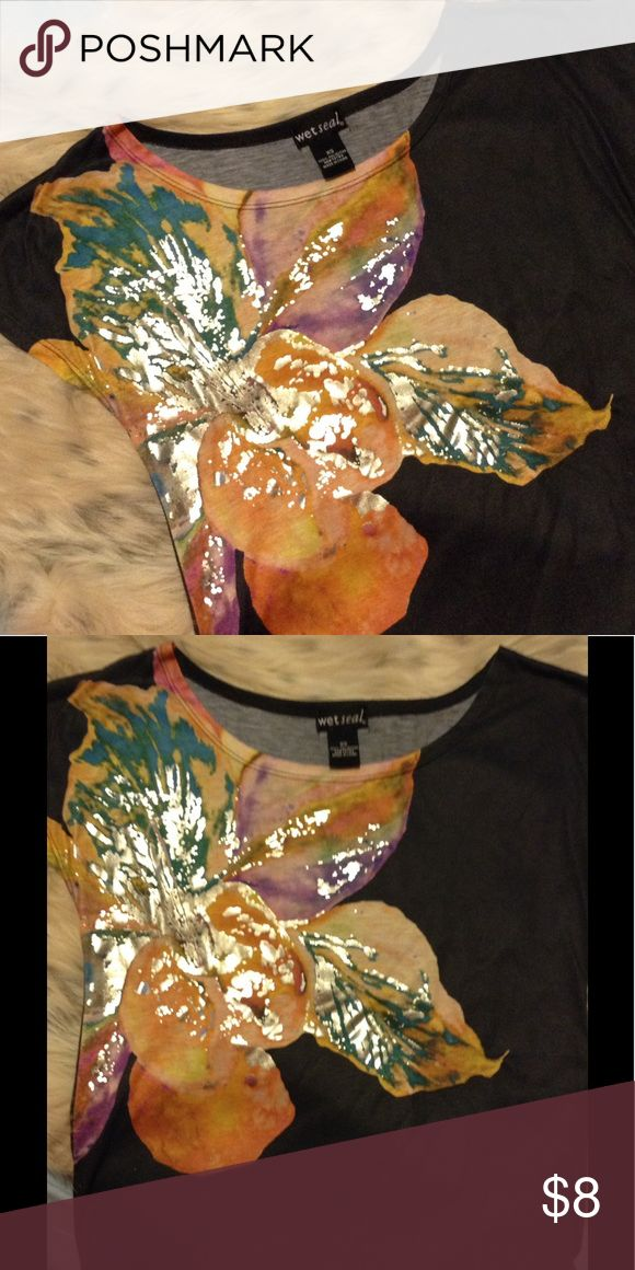 Flower Tee Shirt EUC. Beautiful shirt with large flower. 100% Polyester. Wet Seal Tops Tees - Short Sleeve
