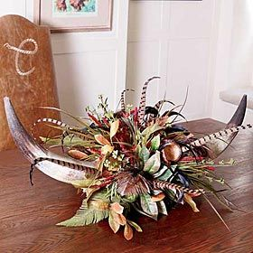 Red Yarrow Double Horn Centerpiece:  Think something like this might be doable, too.  Only, with deer antlers?