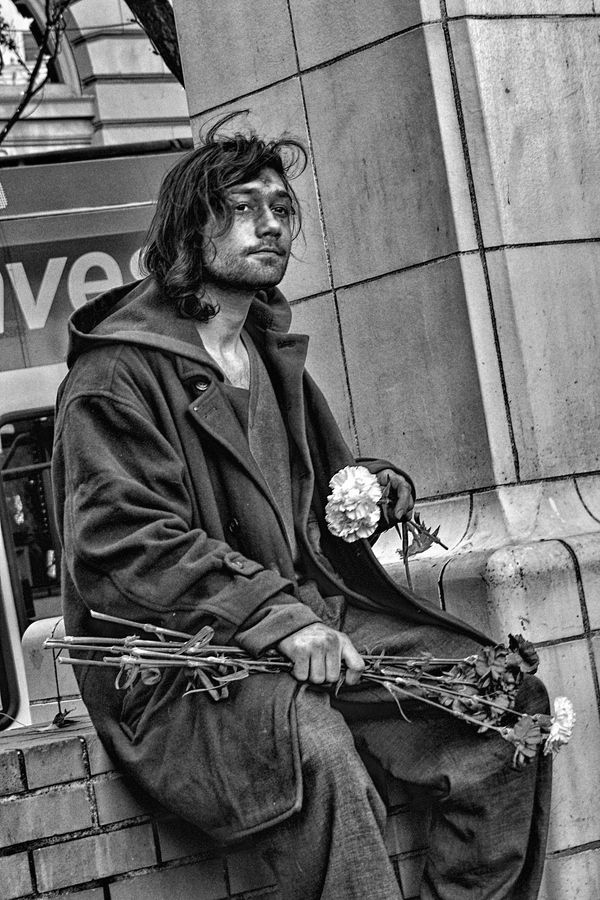 "Photo by Chad Estes: ""He walked around Pioneer Square in Portland holding his carnations like they were his dreams."""