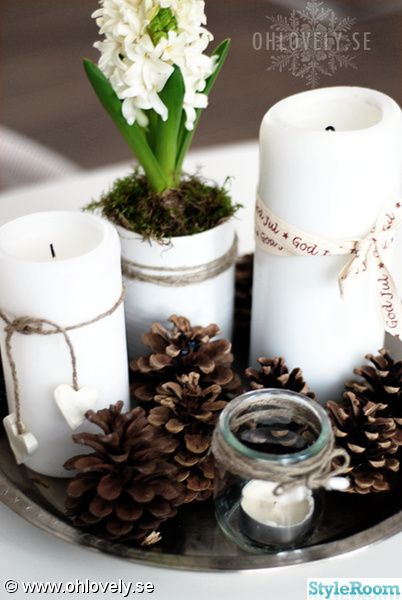 Beautiful, simple arrangement. Bulbs, pine cones, candles, white, silver tray