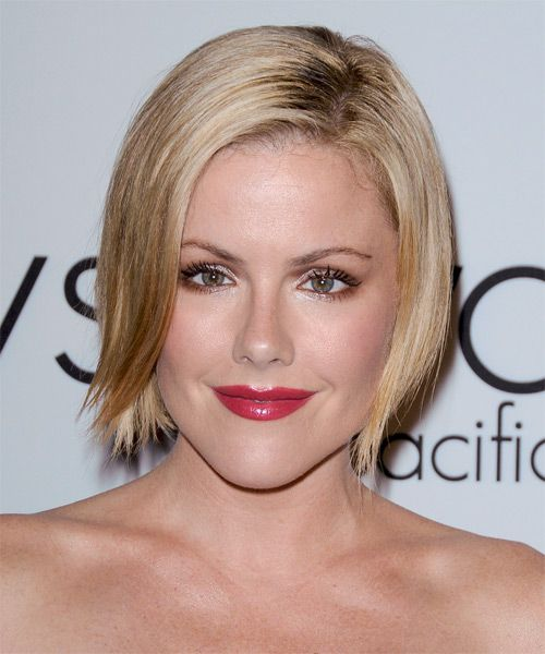 Kathleen Robertson-This short blonde 'do is jagged cut through the ends to achieve a piecey finish to the edges. This look is best suited for those with fine to medium hair