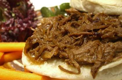 Crockpot Shredded Beef.   Serves about 6, depending on the size of your roast   5 to 8 hours (5 on high, 8 on low)        approx. 4 lb simmering roast, like blade or other pot roast   1 large cooking onion, halved then sliced   1 cup water   2 Tablespoons beef bouillon powder (about 4 packets)   1 tsp dried oregano leaves   1 tsp. chili powder   hot sauce, to taste, OR 1/4 tsp chipotle chile powder OR cayenne (optional)   1/2 cup barbeque sauce, bottled or homemade   1/4 cup ketchup   1/4…