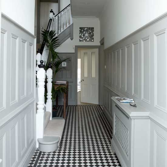 White hallway with panelling