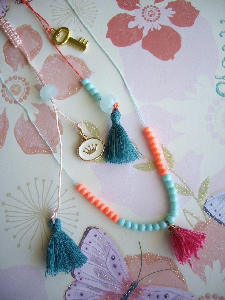 Long pendants with charms, beads and tassels. Code: 25046/1 #jewelleryfromourheart #jewellery #thessaloniki #accessories #necklace #colours #charms #crown #new #spring #ss2016 #tassel
