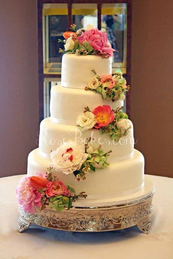 White Wedding Cake with Cascading Fresh Flowers ...