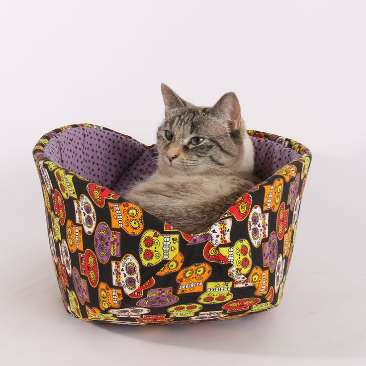 A Cat Canoe modern cat bed, made from a cure sugar skulls fabric. Created and maded by The Cat Ball, LLC in the USA.