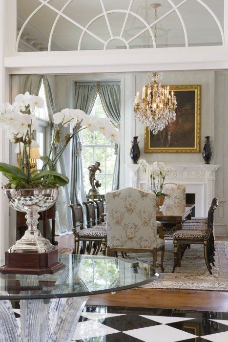 Luxury Dining Room With Fireplace Mantel And Crystal Chandelier