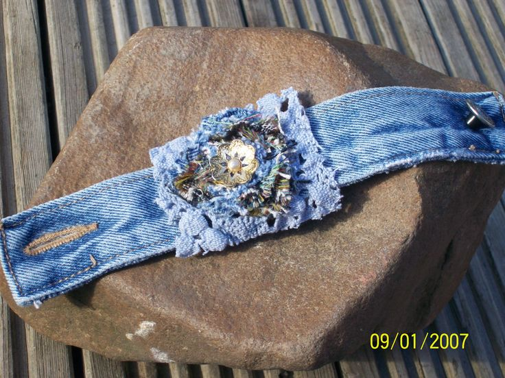 upcycled denim and old jewellery cuff with thick blue lace.   This is a fun alternative bracelet made from a denim jacket sleeve and some old trinkets from the bottom of the jewellery box, the middle is raised with shabby chic style flower with old pearl earring at its centre, really unique great for the summer, fun anf flirty. £6.00  https://www.facebook.com/JenniWrenJewellery?ref=tn_tnmn