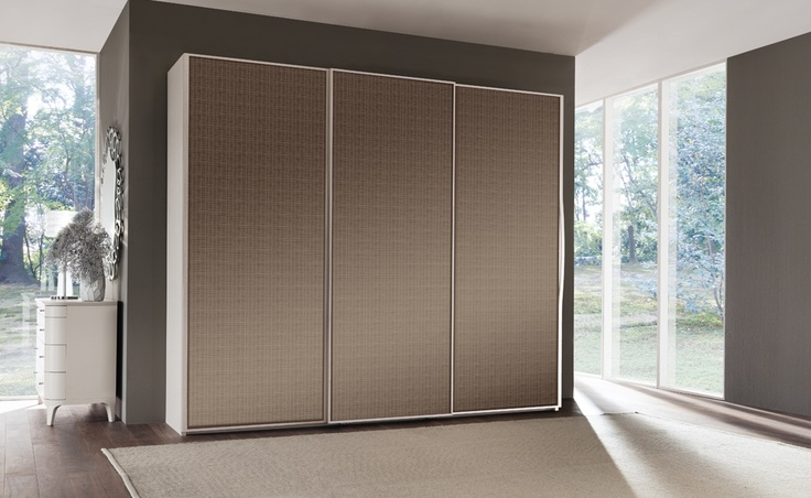 Rosa Trionfante - Melograno   Contemporary Collections Le Fablier   3 sliding doors wardrobe with mirror doors   Measures in cm (LxDxH) 295x67x250    Available with 1 or 3 doors with mirrors or special glasses   Standard equipment: 1 chest of drawers - 3 shelves - 3 clothes hangers