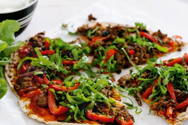 Spicy Lamb Flatbread Pizzas - A pizza without cheese? Yes! This version, with its spiced topping, is tasty and healthy, too.