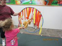 Toddler Circus Activity- make a lion jump through a ring of fire