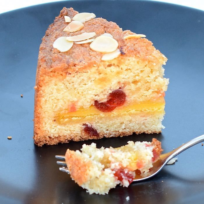 Delicious almond sponge with cherries and a layer of gooey marzipan in the centre.