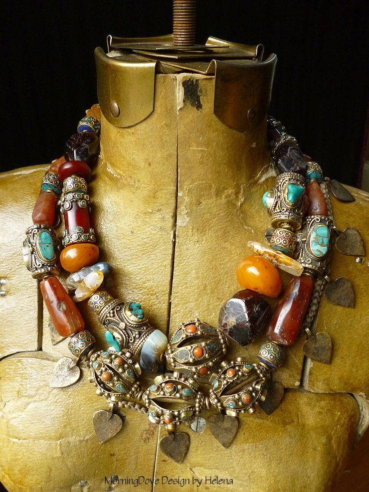 Necklace | Helena Nelson - Reed.  Contemporary Asian Baroque style beads are combined with old stone beads, resin amber beads and brass heart pendants.