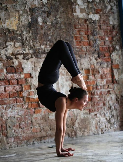 Happy handstand scorpion. A yoga pose for strength, flexibility and focus. Enjoyed and repinned by yogapad.com.au