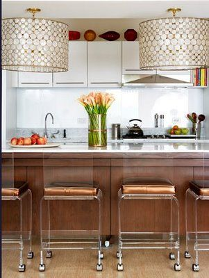 Modern Coastal Kitchen Design With Capiz Shell Drum Pendant Chandelier Island Lights Cabinets Hardware Lucite Stools On Wheels Shiny