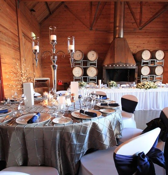 Gray and navy blue wedding theme, beautiful wedding table arrangement, wedding table round, wedding reception tablescapes at Frogmore Creek Wines