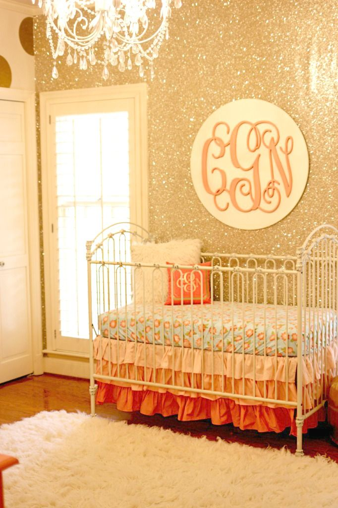 The glitter wallpaper accent wall is so gorgeous! And I spy @CadenLane baby bedding. #nursery