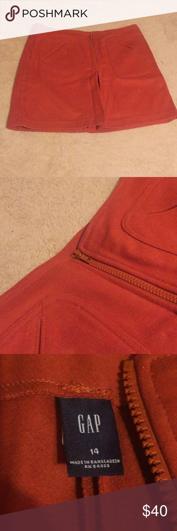 "GAP Virgin Wool Skirt Sz 14 NWOT! Burnt orange skirt 17"" long waist 17"" front zipper front pleat slit front pockets. Not lined very cute just too short for me.  Size 14 GAP Skirts Mini"