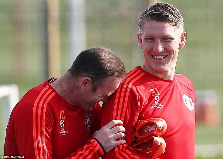 Rooney puts his head on Schweinsteiger's shoulder in a fit of laughter as the experienced duo prepare for another European fixture